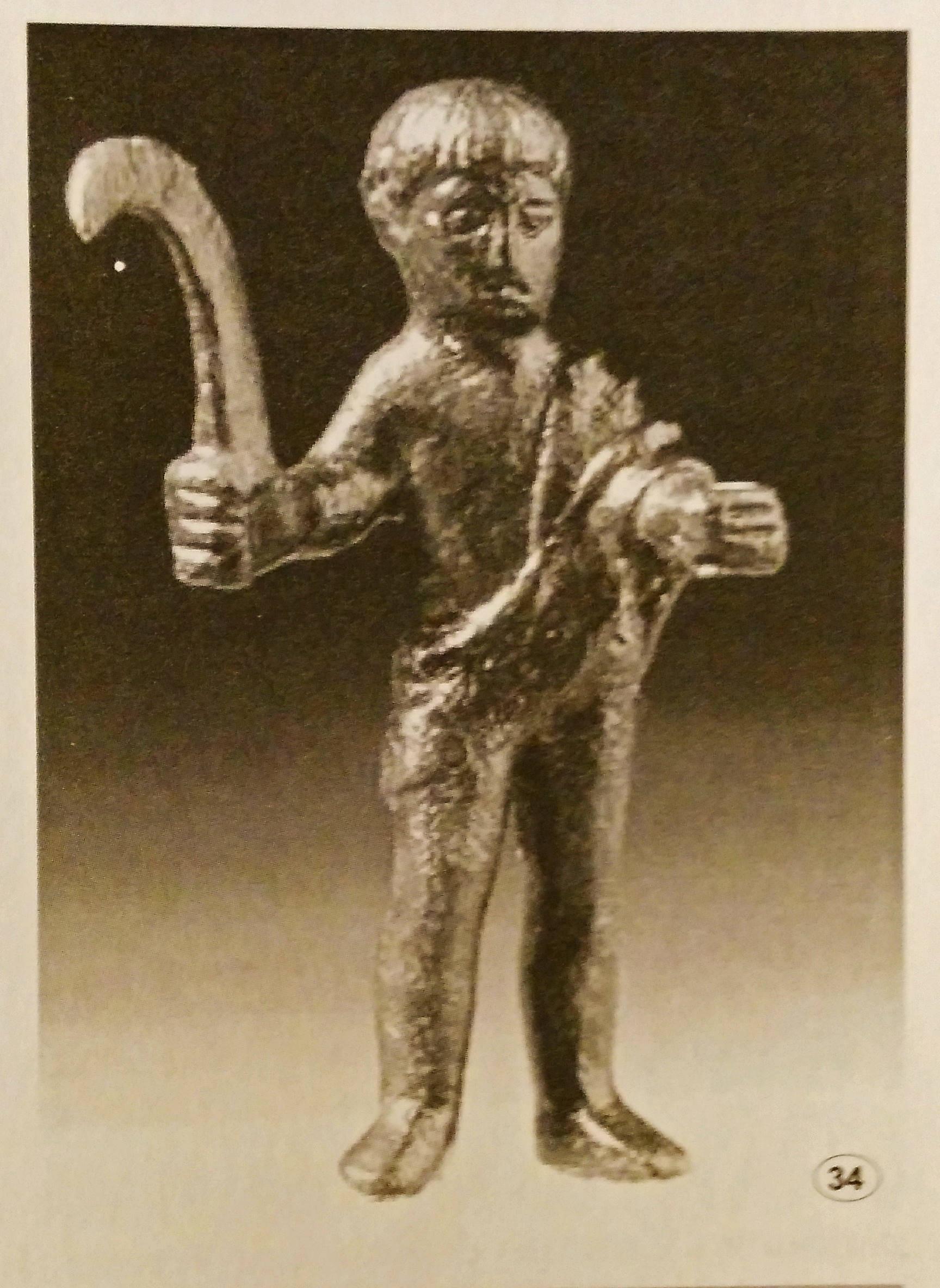 God Silvano Etruscan - Ghiaccioforte (Grosseto) Etruscan bronze votive III century b.C. Young naked man with a ''pennato'' in his right hand.